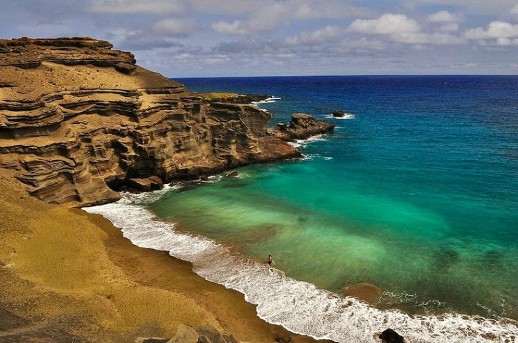 Explore the green sand of Papakolea Beach