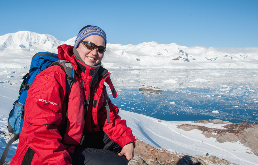 A woman wearing sunglasses in Antarctica