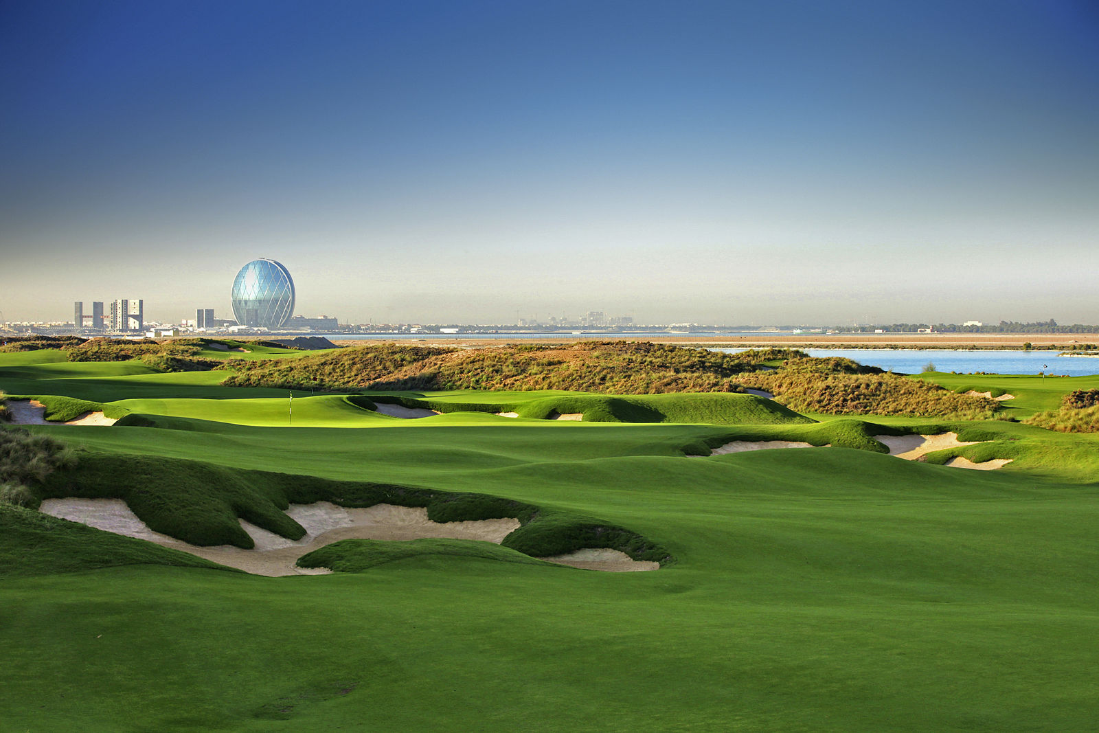 15 bucket list golf vacations lost waldo for Abu dhabi country club salon